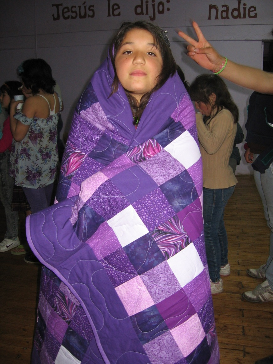 Girl with one of the Quilts given to all the Hogar Girls