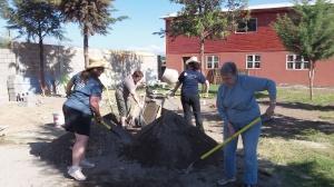 Ladies Shoveling Mortar